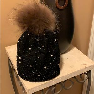 Simon Chang - slouch hat with pom-pom.